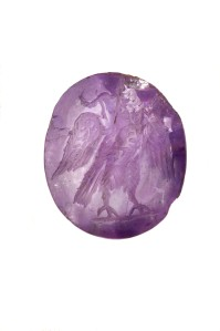 Amethyst intaglio depicting an eagle late 2nd - early 3rd century AD. On show with the Cheapside Hoard. Copyright Museum of London