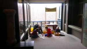 Family fun - Everyone enjoying making a human skeleton - Dorset County Museum