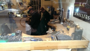 A modern jewellers shop front window, the workshop is not so different