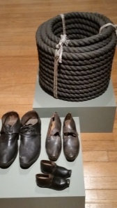 Rope and workers shoes a reminder of hard work and suffering