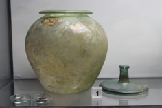 Glass cremation urn with lid, found in Southwark, London.