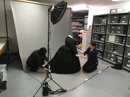 Conservators at the Museum of London display the dress