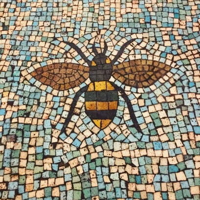 Bee floor mosaic in the enrance
