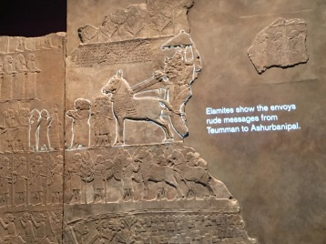 The panel tells the story of the Elamite threat.